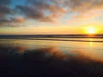 Strand på solnedgången Arkivbild
