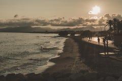 Strand på solnedgången i Europa royaltyfria bilder