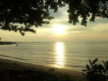 Strand, Sand und Sonnenaufgang Lizenzfreies Stockbild