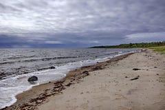 Strand in slecht weer Stock Foto
