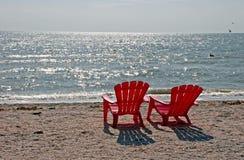 Strand-Stühle Stockfoto