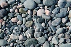 Strand-Steine, Felsen, Kiesel stockfoto