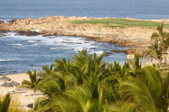 Strand und Golf Stockbild