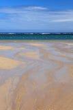 Strand und Strom und das schöne Meer Stockbild