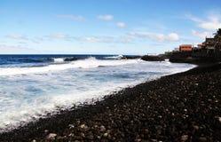 Strand voll von Steinen Stockfotografie