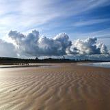 Strand-Wolken Stockbild