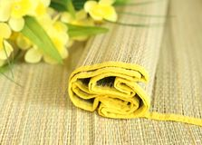 strand woven bamboo and yellow flowers Royalty Free Stock Photo