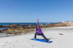 Strand-Yoga Stockbild
