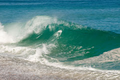 strandavbrottswave Arkivfoto