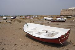 Stranded. Fishing boats while low tide on the ocean bottom Stock Photography