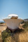 Stranded abandoned Boat on the shoreline. Royalty Free Stock Image