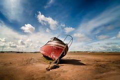Stranded Boat. Boat stranded on a beach Stock Photo