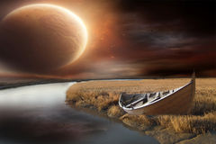 Stranded boat beside Lake. With big moon royalty free stock photography
