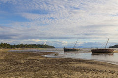 Stranded boat on a low tide beach in Madagascar Royalty Free Stock Photography