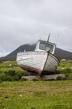 Stranded boat on a Scottish green field. Royalty Free Stock Photo