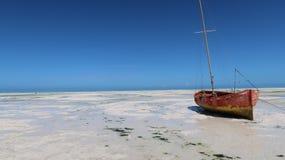 Stranded boat in Zanzibar, Tanzania royalty free stock image