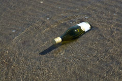 Stranded bottle with mail Royalty Free Stock Images