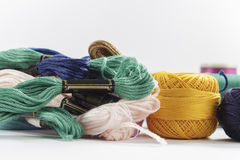 Stranded cotton threads, and skeins, of different colors Stock Photos