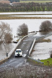 Stranded driver and river in flood Royalty Free Stock Photo