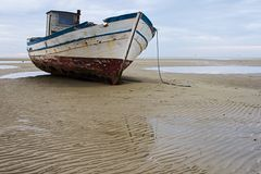 Stranded fishing boat Royalty Free Stock Photography