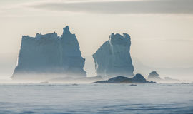 Stranded icebergs in the misty waters of the Labrador sea at mid Stock Image