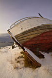 Stranded old fishing boat Stock Images