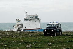 Stranded petrol ship in Sicily. Syracuse, Sicily - March 11: an petrol cargo ship is stranded in the cost of syracuse cause of the bad weather condition, an 4x4 Royalty Free Stock Photos