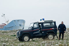 Stranded petrol ship in Sicily and italian police Royalty Free Stock Photo