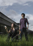 Stranded picture of Asian Couple posing outdoors Stock Photo