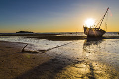 Stranded ship anchored on a sunset in Madagascar Stock Photo