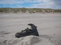 Stranded shoe on beach Royalty Free Stock Photo