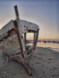 Stranded. Used in traditional fishing boat abandoned on the beach Stock Image