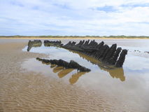 Stranded wreck of a wooden barque. The wreck of the Norwegian sailing barque SS Nornen which sank in March 1897 exposed on the beach at Burnham on Sea, England royalty free stock photography