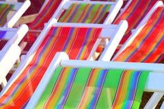 stranden chairs färgrikt Fotografering för Bildbyråer