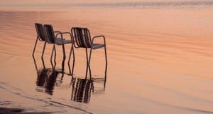 stranden chairs tre Arkivfoton
