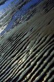stranden ripples den tidvattens- sanden Fotografering för Bildbyråer
