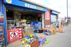 Stranden shoppar Arkivbild