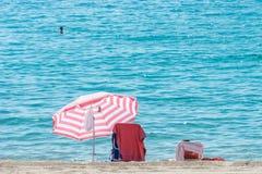 strandett slags solskydd Arkivfoton