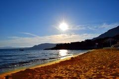 strandexponeringsfeelen ger långsamma slappa waves för solnedgång mycket Royaltyfria Foton