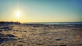 Strandhavssikt i aftonsolen Arkivfoto