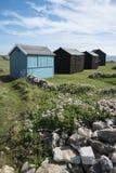 Strandhutten bij de Rekening van Portland, Dorset, het UK. Stock Afbeeldingen
