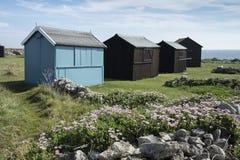 Strandhutten bij de Rekening van Portland, Dorset, het UK. Stock Foto