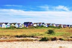 Strandhutten met blauwe hemel Stock Foto