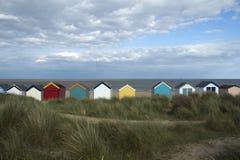 Strandkojor på Southwold, Suffolk, England Arkivbild