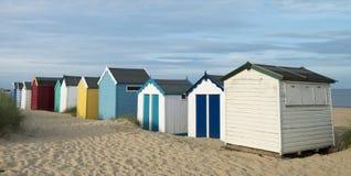 Strandkojor på Southwold, Suffolk, UK fotografering för bildbyråer
