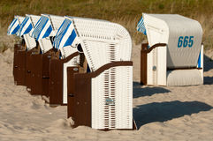 Strandkorb, Strandkoerbe, beach chairs. Strandkorb, Beach chairs on beach at Binz seaside resort on Rugen Island in Germany Royalty Free Stock Photography