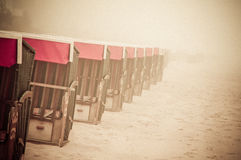 Strandkorb, Strandkoerbe, beach chairs. Strandkorb, Beach chairs on beach at Binz seaside resort on Rugen Island in Germany Royalty Free Stock Image