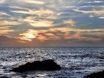 strandlaguna solnedgång Arkivbild