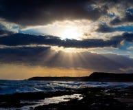 Strandlandschaft am Sonnenaufgang Stockfotografie