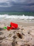 Strandleksaker i sanden Royaltyfria Bilder